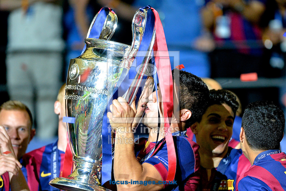 Luis Su&aacute;rez of FC Barcelona celebrates with the trophy following the UEFA Champions League Final at Olympiastadion Berlin, Charlottenburg-Wilmersdorf<br /> Picture by Ian Wadkins/Focus Images Ltd +44 7877 568959<br /> 06/06/2015