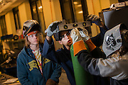 Mechanical Engineering students practice their welding at the machine shop in the Herak Center for Engineering on campus. (Photo by Rajah Bose)