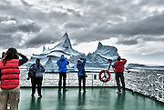 People on board ship photographing iceburgs in Antactica.