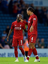 BLACKBURN, ENGLAND - Thursday, July 19, 2018: Liverpool's Virgil van Dijk (right) shares a joke with new signing Naby Keita during a preseason friendly match between Blackburn Rovers FC and Liverpool FC at Ewood Park. (Pic by David Rawcliffe/Propaganda)