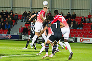 Salford City defender Cameron Burgess head the ball during the EFL Sky Bet League 2 match between Salford City and Grimsby Town FC at Moor Lane, Salford, United Kingdom on 17 September 2019.