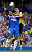 Photo: Daniel Hambury.<br />Chelsea v Manchester City. The Barclays Premiership. 20/08/2006.<br />Chelsea's Didier Drogba and City's Richard Dunne