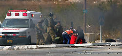 20.10.2015, Bethlehem, PSE, Gewalt zwischen Palästinensern und Israelis, im Bild Ausschreitungen, Demostrationen und Zusammenstösse zwischen Palästinensischen Demonstranten und Israelischen Sicherheitskräfte // Israeli soldiers inspect the scene where a settler was ran over by a Palestinian truck driver in an incident that followed stone-throwing near Al Fawar Refugee camp near Hebron city, 20 October 2015. The Israeli settler was pronounced dead on site. Israeli media said the Israeli was a 50-year-old man from the settlement of Kiryat Arba, the man who ran him over, reportedly a Palestinian truck driver, later turned himself in to Palestinian police in the nearby town of Dhahiriya, southwest of Hebron saying it was an accident, Palestine on 2015/10/20. EXPA Pictures © 2015, PhotoCredit: EXPA/ APAimages/ Muhesen Amren<br /> <br /> *****ATTENTION - for AUT, GER, SUI, ITA, POL, CRO, SRB only*****