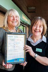 Lloyds Pharmacy Stocksbridge has achieved the status of 'Healthy Living Pharmacy'. A special accreditation for offering high levels of health screening  and advice to the local community. Pharmacy Manager Jackie Walter receiving the award from Mayor of Stocksbridge Susie Abrahams, <br /> <br /> 04 October 2012<br /> Image © Paul David Drabble
