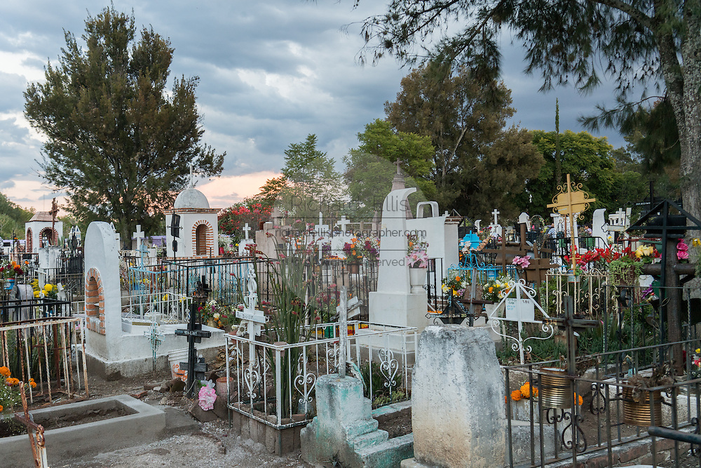 Storm clouds gather over the Nuestra Señora de Guadalupe cemetery during the Day of the Dead festival November 1, 2016 in San Miguel de Allende, Guanajuato, Mexico. The week-long celebration is a time when Mexicans welcome the dead back to earth for a visit and celebrate life.
