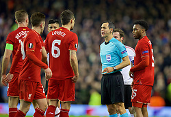 LIVERPOOL, ENGLAND - Thursday, March 10, 2016: Referee Carlos Velasco Carballo shows a yellow card to Dejan Lovren during the UEFA Europa League Round of 16 1st Leg match against Manchester United at Anfield. (Pic by David Rawcliffe/Propaganda)
