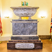 Smithsonian Castle James Smithson Crypt. The Smithson Crypt, in the Smithsonian Castle, contains the remains of James Smithson (1765-1829), the founder of the Smithsonian Insttitution. Formally known as the Smithsonian Institution Building, the Smithsonian Castle houses the administrative headquarters fo the Smithsonian Institution as well as some a permanent exhibition titled Smithsonian Institution: America's Treasure Chest. It's distinctive architectural style stands out on the southern side of the National Mall in Washington DC.
