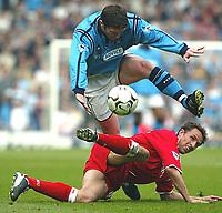 Photo Aidan Ellis.<br />Manchester City v Middlesboro (FA Barclaycard Premiership) 12/04/2003.<br />City's jon Macken and Boro's Gareth Southgate