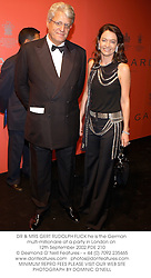 DR & MRS GERT RUDOLPH FLICK he is the German multi-millionaire at a party in London on 12th September 2002.	PDE 210