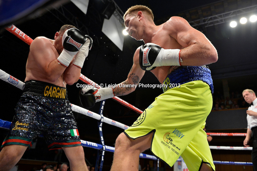 Ricky Summers  (yellow/blue shorts) defeats Curtis Gargano in a Light Heavyweight contest at Wolverhampton Civic Hall, Wolverhampton, 1st August 2014. Frank Warren in association with PJ Promotions.  © Credit: Leigh Dawney Photography.
