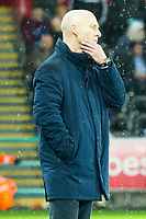 Football - 2016 / 2017 Premier League - Swansea City vs. Stoke City<br /> <br /> Swansea City manager Bob Bradley strokes his chin on the touchline at the end of the game after his team win 2-0—, at The Liberty Stadium.<br /> <br /> COLORSPORT/WINSTON BYNORTH