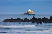 The early morning sun illuminates the Tillamook Rock Lighthouse, which sits more than a mile off the Oregon coast between Cannon Beach and Seaside. The lighthouse was first used in 1881 and decommissioned in 1957. Because of the severe weather and difficult access, it was expensive to maintain. Most recently it has been used as a columbarium. The ashes of about 30 people are placed there.