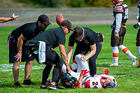 KELOWNA, CANADA - SEPTEMBER 16: Running back Rhett Williams #24 of the Vancouver Island Raiders is attended to on the field by team medical staff at the Okanagan Sun on September 16, 2018, at the Apple Bowl, in Kelowna, British Columbia, Canada.  (Photo by Marissa Baecker/Shoot the Breeze)  *** Local Caption ***