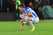 Eric Durm (37) of Huddersfield Town crouches down looking dejected at full time after a 2-1 loss to Bournemouth during the Premier League match between Bournemouth and Huddersfield Town at the Vitality Stadium, Bournemouth, England on 4 December 2018.