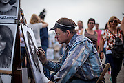 Painter Pavel, who is earning his living with portraits of tourists at Charles Bridge during a Saturday afternoon. His real art are abstract paintings he creates in his free time. Every artist working on Charles Bridge has to go through a selection process in front of a jury to get permission to work on the bridge.