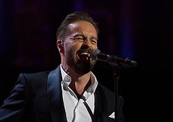 Alfie Boe performing at the Royal Albert Hall in London during a star-studded concert to celebrate the Queen's 92nd birthday.