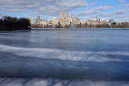 The Reservoir in Central Park with the twin towers of the El Dorado apartment building amid the west side skyline.