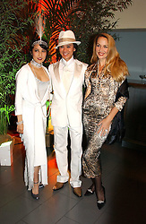 Left to right, ANDY & PATTI WONG and JERRY HALL at Andy & Patti Wong's Chinese New Year party to celebrate the year of the Rooster held at the Great Eastern Hotel, Liverpool Street, London on 29th January 2005.  Guests were invited to dress in 1920's Shanghai fashion.<br />