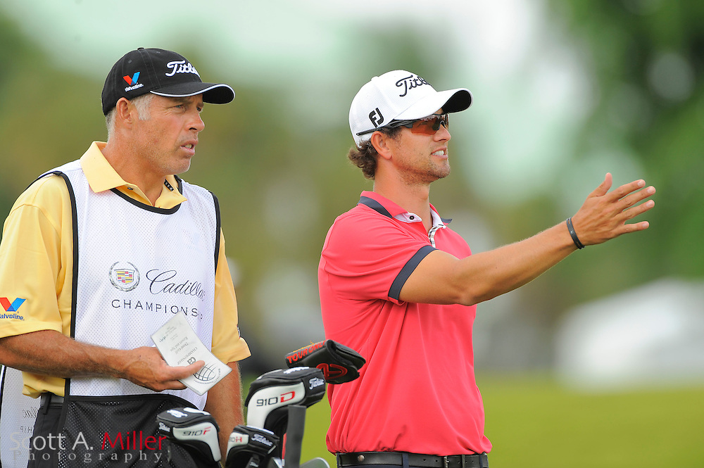 Adam Scott and hois caddie Steve Williams during the first round of the World Golf Championship Cadillac Championship on the TPC Blue Monster Course at Doral Golf Resort And Spa on March 8, 2012 in Doral, Fla. ..©2012 Scott A. Miller.