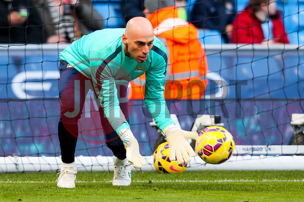 Manchester City's Willy Caballero warms up ahead of the Barclays Premier League clash between Manchester City and Newcastle United - Photo mandatory by-line: Matt McNulty/JMP - Mobile: 07966 386802 - 21/02/2015 - SPORT - Football - Manchester - Etihad Stadium - Manchester City v Newcastle United - Barclays Premier League