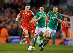 DUBLIN, REPUBLIC OF IRELAND - Friday, March 24, 2017: Wales' Gareth Bale in action against Republic of Ireland's David Meyler during the 2018 FIFA World Cup Qualifying Group D match at the Aviva Stadium. (Pic by David Rawcliffe/Propaganda)
