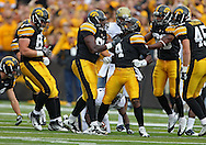 September 17, 2011: Iowa Hawkeyes defensive back Jordan Bernstine (4) is pumped up after a play during the first half of the game between the Iowa Hawkeyes and the Pittsburgh Panthers at Kinnick Stadium in Iowa City, Iowa on Saturday, September 17, 2011. Iowa defeated Pittsburgh 31-27.
