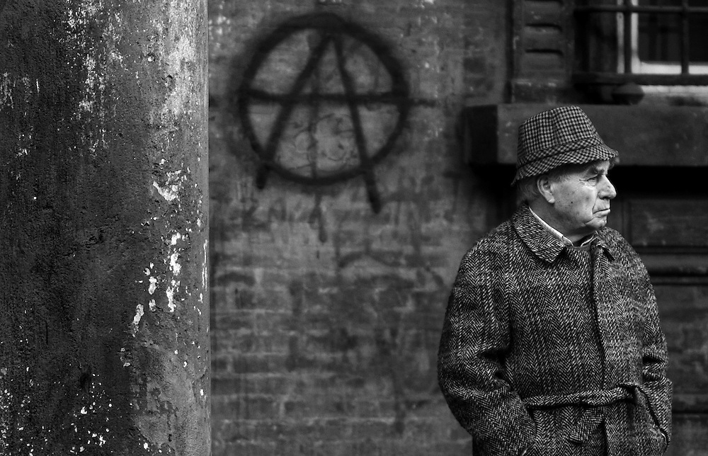 Anarchy in Bologna | Limited Edition 1 of 10.<br /> Black and white photography. Man in coat in Bologna Italy.