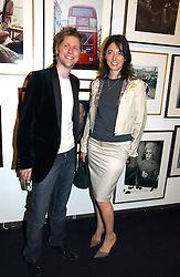 MARY McCARTNEY and CHRISTOPHER BAILEY creative director of Burberry at a party to celebrate the opening of Photo-London 2006 at Burlington Gardens, London W1 on 17th May 2006.<br />