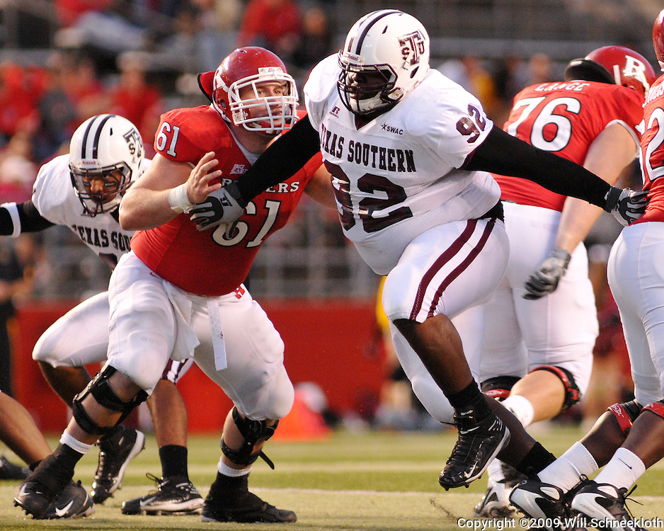Oct 10, 2009; Piscataway, NJ, USA; Texas Southern defensive lineman Fred Gaines battles past Rutgers center Ryan Blaszczyk (61) during second half NCAA college football action in Rutgers' 42-0 victory over Texas Southern at Rutgers Stadium.