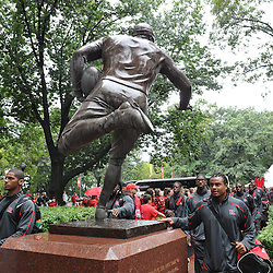 Sep 12, 2009; Piscataway, NJ, USA;  Rutgers linebacker Damaso Munoz touches the statute commemorating the first college football game on the Scarlet Walk before Rutgers hosts Howard in NCAA College Football at Rutgers Stadium.