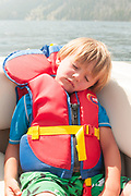 Little boy falls asleep on the boat. Red Fish Lake. Stanley, Idaho. MR