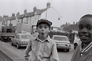 Young boy pulls a face, Southall, UK, 1987.