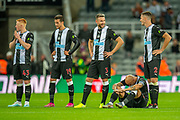 Jonjo Shelvey (#8) of Newcastle United FC sits with his head bowed after missing a penalty during the penalty shoot-out of the EFL Cup match between Newcastle United and Leicester City at St. James's Park, Newcastle, England on 28 August 2019.