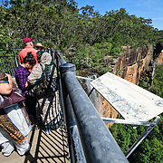 Tourists on the lookout at the waterfalls at Fitroy Falls in the Kangaroo Valley near the Central Coast of New South Wales