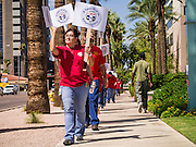 12 SEPTEMBER 2012 - PHOENIX, AZ:  A CWA member clinches her fist as she and her coworkers picket the CenturyLink offices. About 100 members of the Communication Workers of America (CWA) Local 7019 picketed the CenturyLink (formerly Qwest) offices in Phoenix Wednesday. The CWA and CenturyLink entered contract negotiations on August 15. The negotiations cover more than 15,000 workers across the western United States. Key issues include outsourcing and proposed cuts to retiree health benefits.    PHOTO BY JACK KURTZ