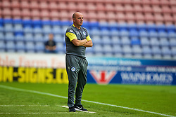 WIGAN, ENGLAND - Friday, July 14, 2017: Wigan Athletic's manager Paul Cook during a preseason friendly match against Liverpool at the DW Stadium. (Pic by David Rawcliffe/Propaganda)