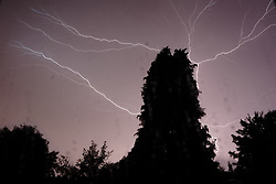 July 19, 2017 - Surrey, England, United Kingdom - Lightning and thunder fill the night air as a lighting storm passes over Surrey in southern England, on 19  July 2017, during a hot summers night. (Credit Image: © Jay Shaw Baker/NurPhoto via ZUMA Press)