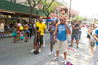 "53rd street was lined with events and activities for people of all ages as he 14th Annual Silver Room Block Party was held this Saturday, July 15th, 2017 along 53rd Street between Lake Park and Blackstone Ave. <br /> <br /> 9143 – Don Lynch and his daughter Cameron enjoy a performance by OPLUS.<br /> <br /> Please 'Like' ""Spencer Bibbs Photography"" on Facebook.<br /> <br /> Please leave a review for Spencer Bibbs Photography on Yelp.<br /> <br /> All rights to this photo are owned by Spencer Bibbs of Spencer Bibbs Photography and may only be used in any way shape or form, whole or in part with written permission by the owner of the photo, Spencer Bibbs.<br /> <br /> For all of your photography needs, please contact Spencer Bibbs at 773-895-4744. I can also be reached in the following ways:<br /> <br /> Website – www.spbdigitalconcepts.photoshelter.com<br /> <br /> Text - Text ""Spencer Bibbs"" to 72727<br /> <br /> Email – spencerbibbsphotography@yahoo.com"