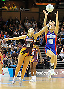 Joline Henry reaches for the ball under pressure from Chelsea Pitman ~ Netball action from ANZ Championship Grand Final - Queensland Firebirds v Northern Mystics - played at the Brisbane Convention Centre on Sunday 22nd May 2011 ~ Photo : Steven Hight (AURA Images) / Photosport