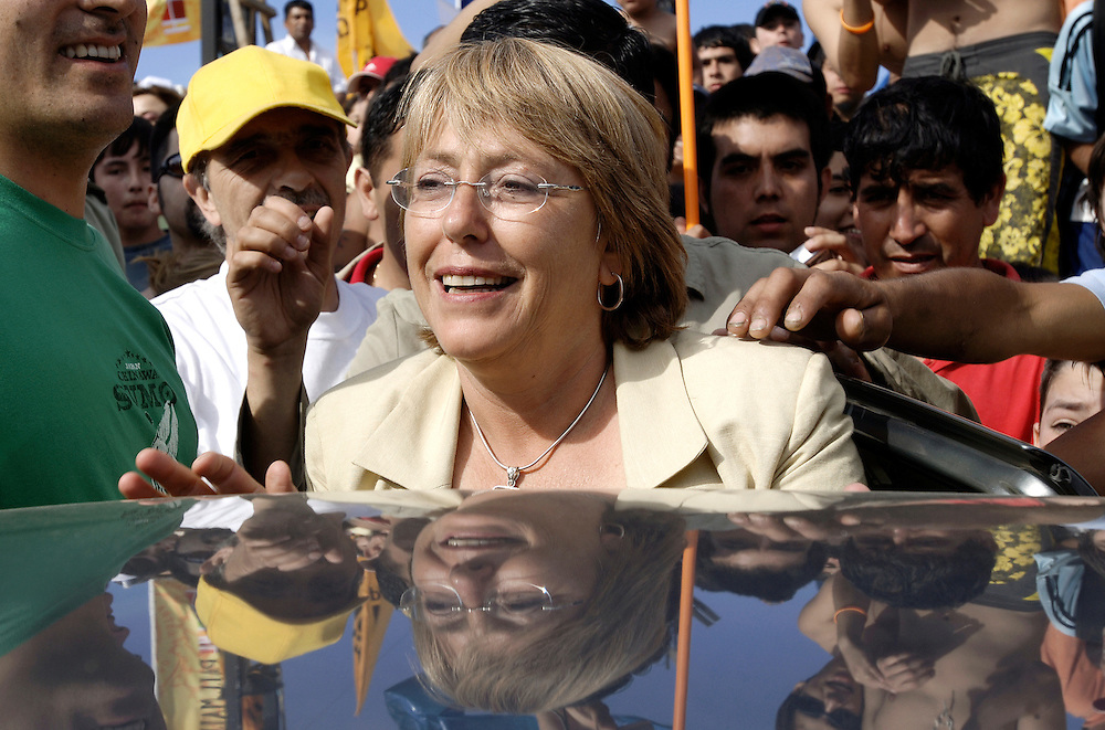 Cartagena, Chile 07 Jaunary 2006<br /> Chile's presidential candidate Michelle Bachelet of the Socialist Party is greeted during a campaign rally. Michelle Bachelet was widely favoured in a poll on Saturday to become Chile's first woman president in an election next week, although a large bloc of undecided voters could still swing the vote.<br /> Photo: Ezequiel Scagnetti
