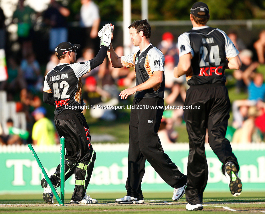 Blackcaps keeper Brendon McCullum and bowler James Franklin celebrate a wicket. KFC Twenty20, New Zealand Blackcaps v Bangladesh, Seddon Park, Hamilton. Wednesday 3rd February 2010. Photo: Simon Watts/PHOTOSPORT