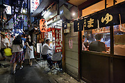 Tokyo, Japan, July 11 2016 - Omoide Yokocho (memory lane) in a bar alley in the  Shinjuku area.