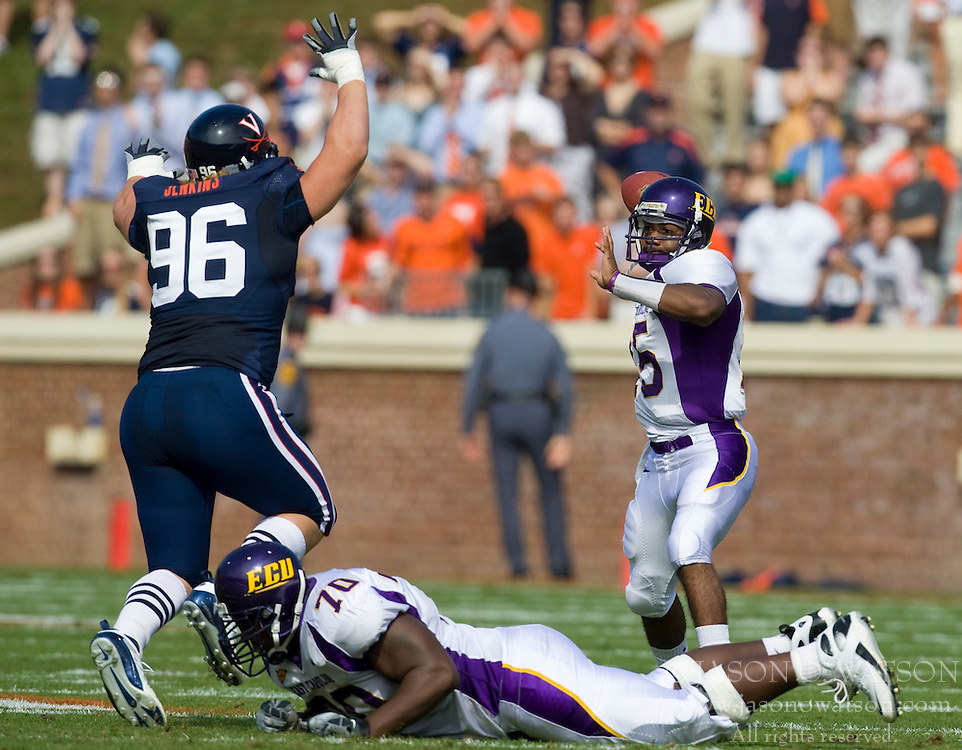 Virginia NT Nick Jenkins (96) puts pressure on East Carolina quarterback Patrick Pinkney (15).  The Virginia Cavaliers defeated the East Carolina Pirates 35-20 in NCAA football at Scott Stadium on the Grounds of the University of Virginia in Charlottesville, VA on October 11, 2008.