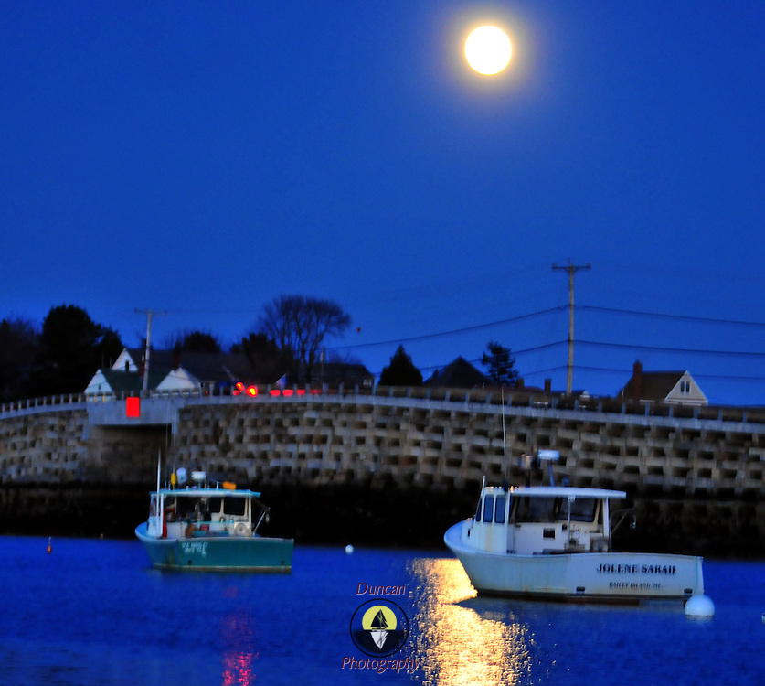 11/21/10 -- HARPSWELL, Maine. The Cribstone Bridge, connecting Orr's and Bailey Islands in Harpswell, opened on Friday.  After $11 million dollars the historic bridge is open, despite signs showing it still under construction. Photo by Roger S. Duncan.