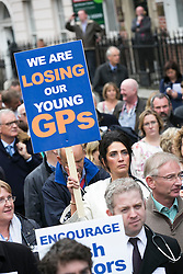 Repro Free: 24/09/2014 Dr Cathy Brogan from Rathkeale Co. Limerick is pictured as for the first time in the history of the state, GPs have been motivated to protest as patient safety is now at risk. GPs (as part of NAGP/ National Association of General Practitioners) outside Leinster House. Picture Andres Poveda