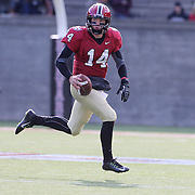 Quarterback Conner Hempel, Harvard, in action during the Harvard Vs Yale, College Football, Ivy League deciding game, Harvard Stadium, Boston, Massachusetts, USA. 22nd November 2014. Photo Tim Clayton