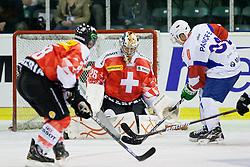 Eric Pance of Slovenia vs Martin Gerber of Switzerland during friendly ice-hockey match between Slovenia and Switzerland, on December 14, 2011 at Hala Tivoli, Ljubljana, Slovenia. (Photo By Matic Klansek Velej / Sportida)