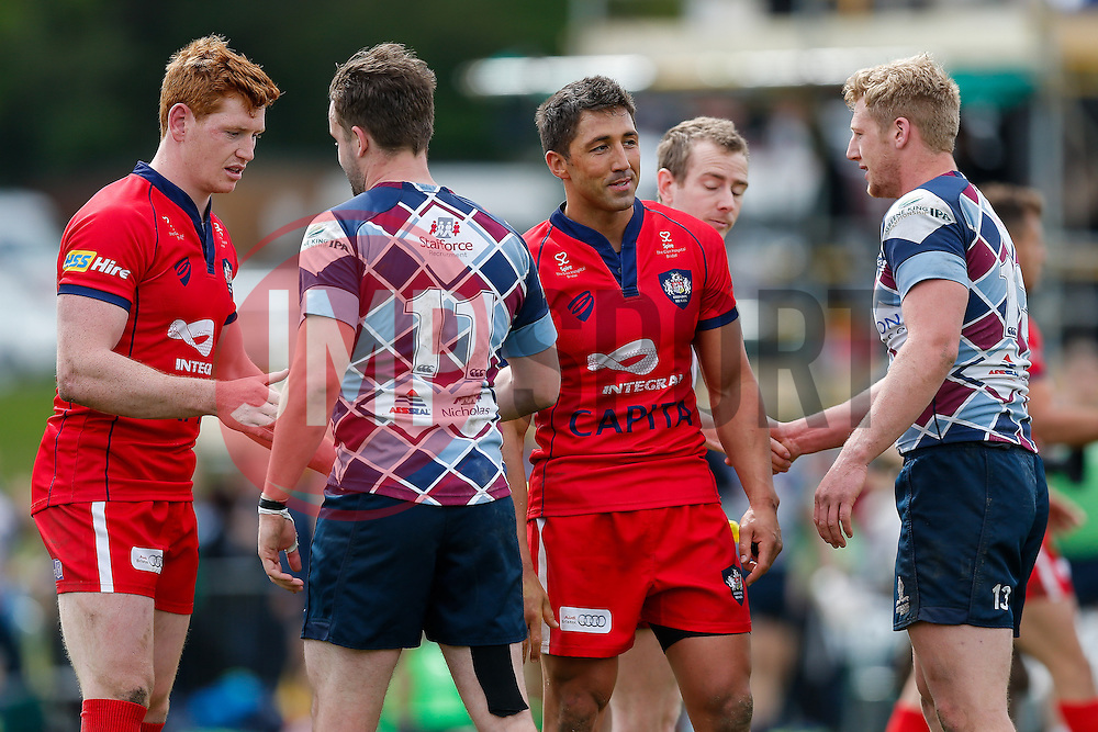 Bristol Rugby replacement Jack Tovey and Inside Centre Gavin Henson are congratulated by Rotherham Titans Winger Michael Keating and Outside Centre Lloyd Hayes after Bristol Rugby win the match to advance to the play off final - Photo mandatory by-line: Rogan Thomson/JMP - 07966 386802 - 10/05/2015 - SPORT - RUGBY UNION - Abbeydale Park, Sheffield - Rotherham Titans v Bristol Rugby - Greene King IPA Championship Play Off Semi Final Second Leg.