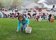 Baylee Zimmerman, 5, of Rowley works her way up the hill during the Church Easter Egg Hunt at Hillside Wesleyan Church, 2600 1st Ave NW, in Cedar Rapids on Saturday morning, March 31, 2012. This year there were over 7,500 eggs up for grabs. (Stephen Mally/Freelance)