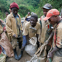 Local mining for gold in the village of Mongbwalu in Eastern Congo. A former Belgian mine has been broken into by local miners and is now being mined again. Congolese army local officials and ex militias are controlling the mining at this highly dangerous site.